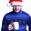 Man in Santa's hat with cup — Stock Photo