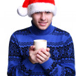 Man in Santa's hat with cup - Foto Stock