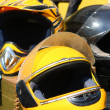 Yellow motobike helmet - Stock Photo