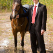 Stock Photo: Bridegroom and horse