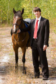 Bridegroom and horse — Stock Photo