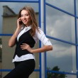Businesswoman with cellphone — Stock Photo #9812969