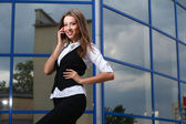 Businesswoman with cellphone — Stock Photo