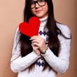 Girl with red heart — Stockfoto
