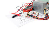 Digital multimeter and the circuit. — Stock Photo