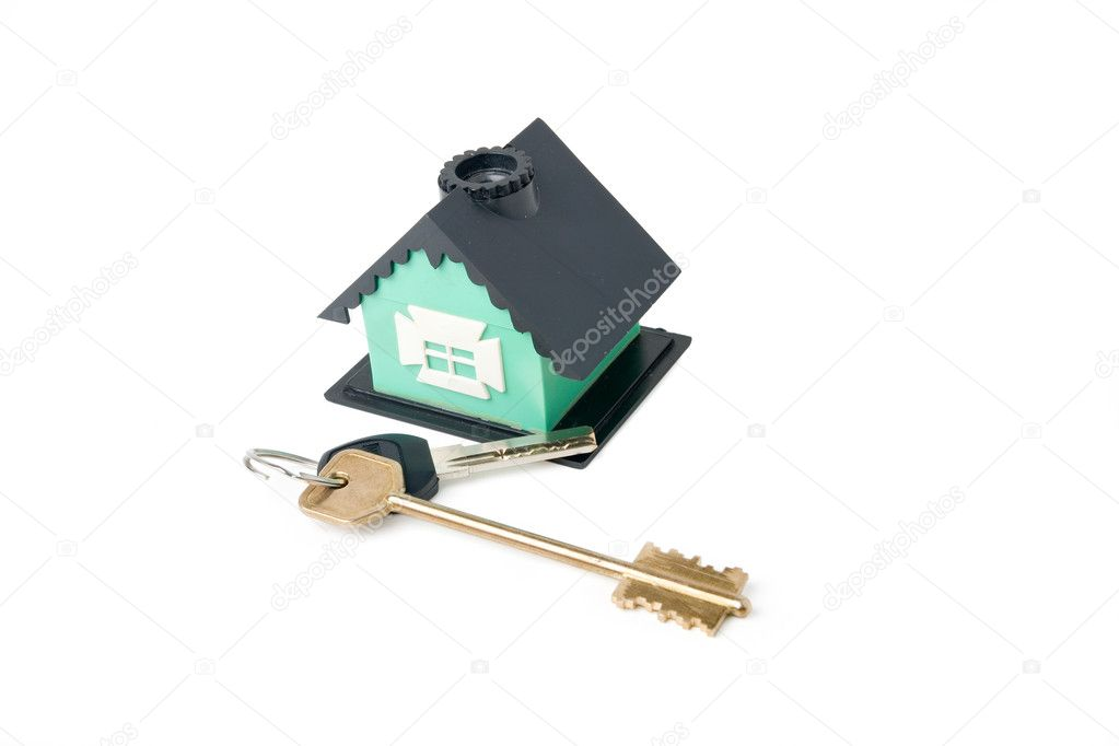 The keys and the house. Clipping path. Isolated on white background  Stock Photo #9274589