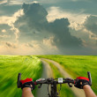 Man with bicycle riding country road — Stock Photo #8019719