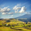 Landscape with village, mountains and blu sky — Stock Photo