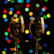 Stock Photo: Two wine glasses on holiday background