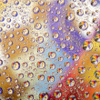 Coloured water drops background - Stock Photo
