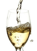 White wine pouring into glass — Stock Photo