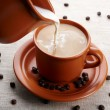 Stock Photo: Cup of coffee and cream