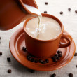 Cup of coffee and cream - Stock Photo