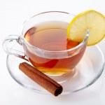 Cup of tea with lemon and cinnamon — Stock Photo