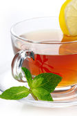 šálek čaje s citronem a mátou — Stock fotografie