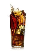 Splashing cola in glass. Isolated on white background — Stock Photo
