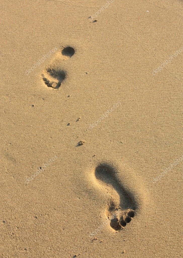 Footprint in the yellow sand  Stock Photo #9685191