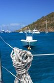 Nautical rope hanging on the sailboat — Stock Photo