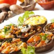 Stuffed portabello mushrooms - Stock Photo