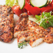 Spicy chicken breasts with vegetable salad — Stock Photo