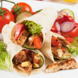 Grilled chicken and salad in tortilla wrap — Stock Photo #10575481