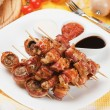 Bacon, chicken and mushroom kebab skewer — Stock Photo