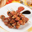 Royalty-Free Stock Photo: Bacon, chicken and mushroom kebab skewer