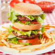 Double hamburger with cheese, lettuce and tomato — Stock Photo