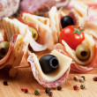 Canape with pickled olives, salami and prosciutto — Foto Stock