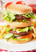 Double hamburger with cheese, lettuce and tomato — Stok fotoğraf