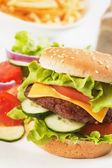Classic hamburger with cheese, tomato and lettuce — Stock Photo