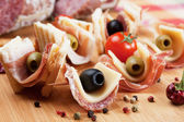 Canape with pickled olives, salami and prosciutto — Fotografia Stock