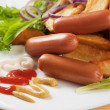Chicken sausage with mustard and roasted potato — Stock Photo