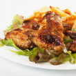 Grilled chicken wings with french fries — Stock Photo #8412770