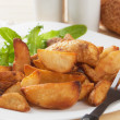 Roasted potato wedges - Stock Photo