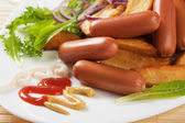 Chicken sausage with mustard and roasted potato — Стоковое фото