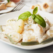 Gnocchi di patata with basilico and cheese sauce - Stock Photo