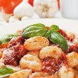 Gnocchi di patata with basilico and tomato sauce - Stockfoto
