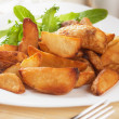 Stock Photo: Roasted potato wedges