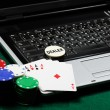 Royalty-Free Stock Photo: Gambling chips and poker cards on a laptop