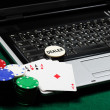 Stock Photo: Gambling chips and poker cards on laptop