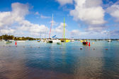 Catamarans and boats in a bay. Grand Bay (Grand Baie). Mauritius — Stock Photo