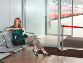 Waiting room and train behind transparent doors — Stock Photo