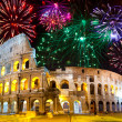 Stock Photo: Celebratory fireworks over Collosseo. Italy. Rome