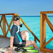 Foto Stock: Boy with flippers, mask and tube at ocean. Maldives.
