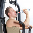 Young man drink water at fitness training — Stock Photo #8780840