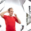 Man poses for the photographer in studio — Stock Photo