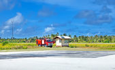 Fire-engine on a take-off field of small tropical island — Stock Photo