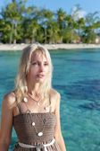 The young woman on a tropical beach — Stock Photo