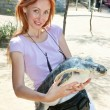 The young woman with a large turtle in hands — Stock Photo #9247694